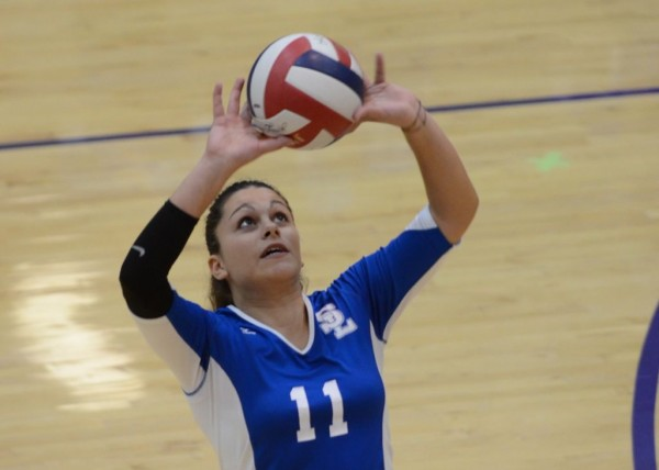 SLCC freshman setter Ailin Donati sets for a teammate against Westminster
