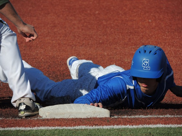 Dives back into first base