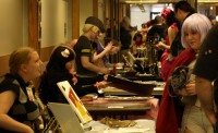 Fans browse the offerings of many vendors at Anime Salt Lake